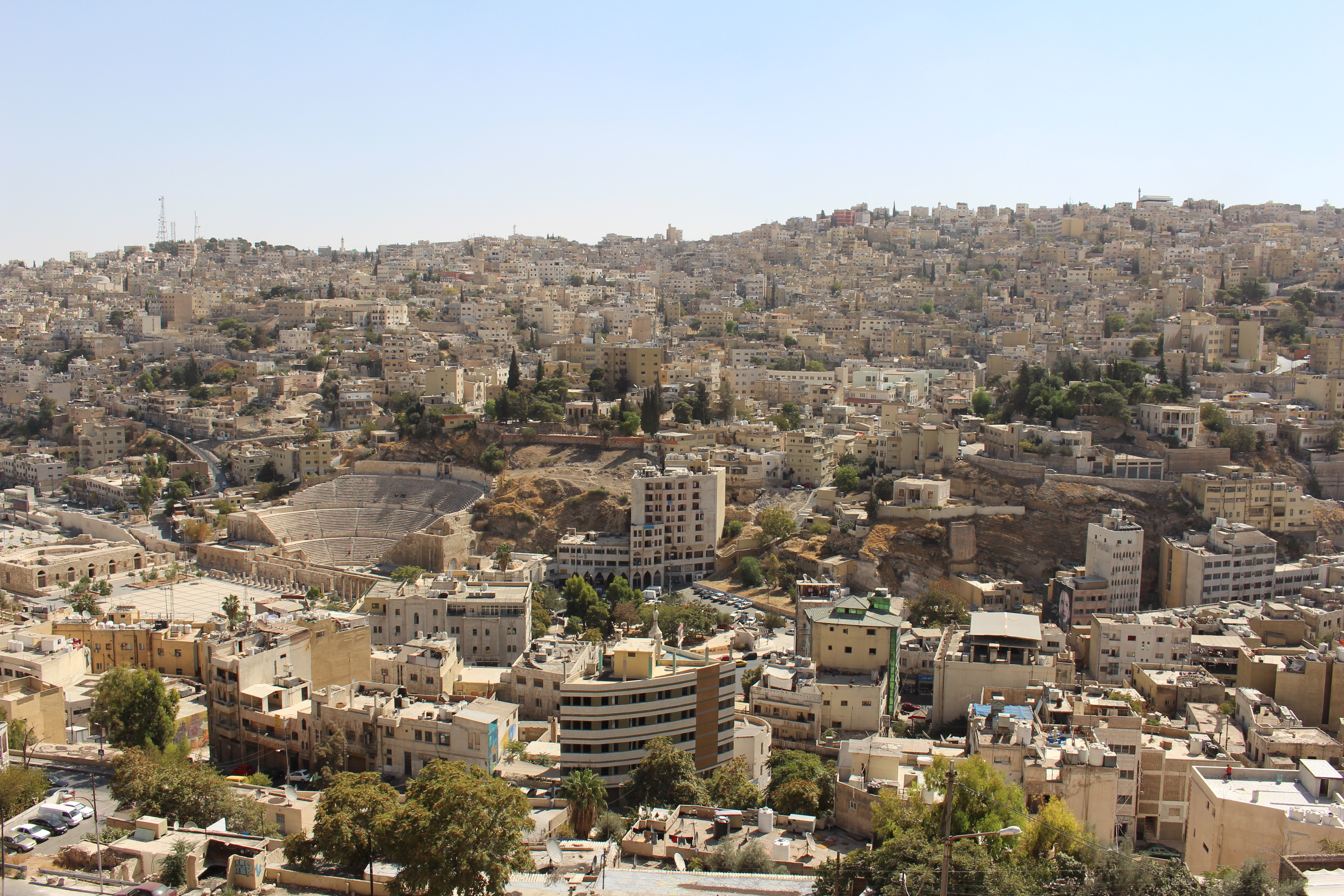 The capital of Jordan is Amman. Amman is a busy city with buildings that stretch almost as far as the eye can see. The buildings almost melt into the hills in varying degrees of beige and brown.